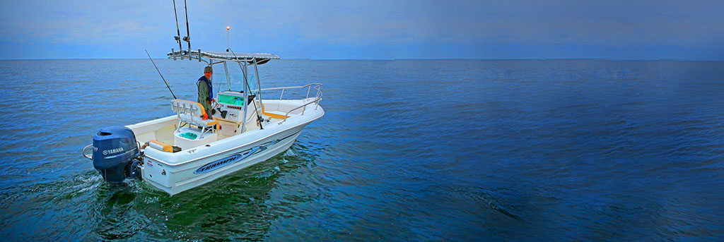 Man in Surf City on Topsail Boat Rental 21 Foot Center Console Triumph Boat